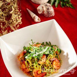 Homemade fresh green spaghetti with prawn and chilli sauce